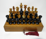 551. Fine Set of French Polished Boxwood and Ebony Chess Pieces in Oak Box early 20thCt